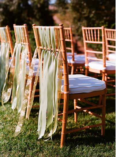 chiavari chairs with green ribbon sashes